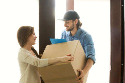 woman receiving cardboard box from man